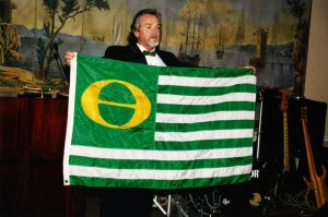 Marc McGinnes holding the Ecology Flag